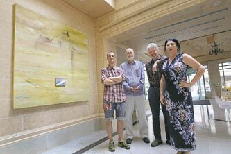 L to R- Craig Love, William Ekin, Cliff Eyland and curator Leala Hewak stand next to artist Dianne Whitehouse's piece called The Light at the End of the Day.