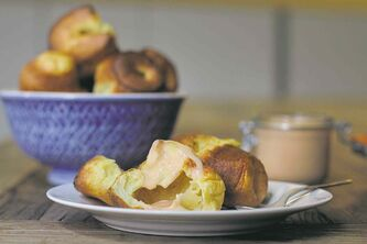 Rhubarb curd atop orange popovers.