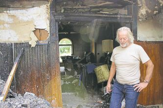 Doug Bergman and the Beausejour landmark he was 90 per cent finished restoring before it burned down July 20. The house is a complete loss. BILL REDEKOP/WINNIPEG FREE PRESS Aug 7,2014