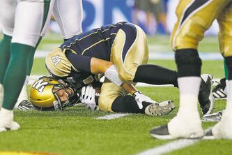 Bombers quarterback Drew Willy in a pose seen all too often the past two seasons in Winnipeg:  a starting quarterback in Blue and Gold writhing in pain on the turf.