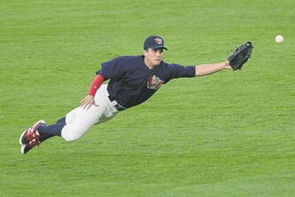 Goldeyes fielder Ryan Pineda stretches in an attempt to come up with the ball during Tuesday's tilt vs. St. Paul.