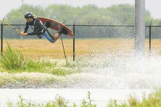 Phtoos by Sarah Taylor / Winnipeg Free Press Mike Fisette of Manitoba flies to first place Saturday in the Canadian National Wake Park Championships at Adrenaline Adventures.