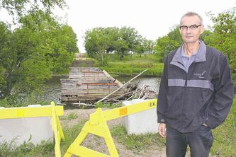 BILL REDEKOP / WINNIPEG FREE PRESS  Former reeve Glen Malkoske argues spending money to fix the bridge that services eight homes isn't right.