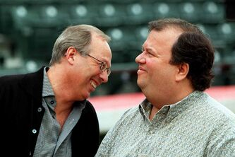 Sam Katz (left) has a private laugh with Sandy Shindleman of Shindico in 1999.