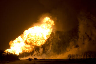 Fire from the natural gas pipeline lights up the sky Saturday  morning near  Otterburne.
