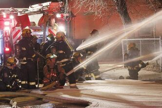 Firefighters work on a fire on Alexander Avenue Tuesday evening.