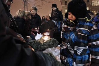 A vigil was held Monday at the University of Winnipeg for six-year-old Ana Grace Marguez-Greene who was killed in Newtown, Conn., Friday, Dec. 14. Young Lucas Gamez lights his candle. Ana's mother taught at the University of Winnipeg and her father taught at the University of Manitoba before moving to Newtown this past July.
