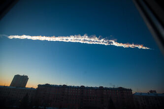 In this photo provided by Chelyabinsk.ru a meteorite contrail is seen over Chelyabinsk. The meteor streaked across the sky of Russia's Ural Mountains on Friday morning, causing sharp explosions.