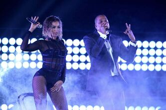 "Beyoncé (left) and, Jay-Z perform ""Drunk in Love"" at the 56th annual Grammy Awards in January 2014."
