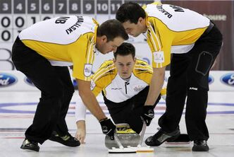 Manitoba skip Rob Fowler (centre) watches his shot as lead Derek Samagalski (left) and second Richard Daneault sweep during a morning draw against Saskatchewan at the Tim Hortons Brier in Saskatoon on Thursday.