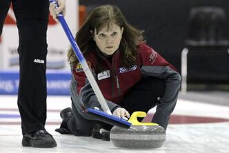 Skip Barb Spencer throws a rock against Team Jennifer Jones in the Friday evening draw of the Scotties Tournament of Hearts in Portage la Prairie at the PCU Centre.