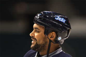 Winnipeg Jets' Dustin Byfuglien smiles during practice at the MTS Centre this morning.