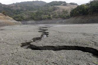 The cracked-dry bed of the Almaden Reservoir is seen on Friday, Feb. 7, 2014, in San Jose, Calif.