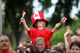 Tristan Davies celebrates with family at the Legislature grounds as part of Canada Day Celebrations in Winnipeg July 1, 2011.