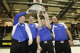 From left: Rob Fowler, skip, Allan Lyburn, third, Richard Daneault, second, and Derek Samagalski, lead, celebrate their win.