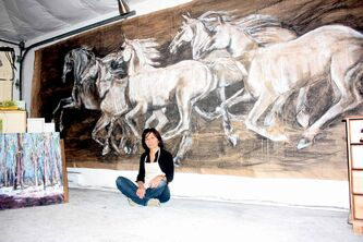 North Kildonan artist Debora Cardaci is shown in her studio with a painting in progress.