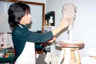 North Kildonan artist Debora Cardaci is shown working on a sculpture in her studio.