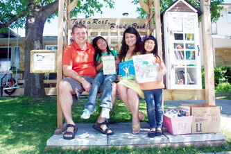 Rory McDonnell and Maria Sanchez started up a Little Free Library on Gilmore Avenue to benefit daughters Naima and Ella.
