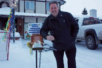 Michael Geiger-Wolf is shown with the donation box for the Canadian Cancer Society outside his North Kildonan home.