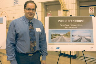 City of Winnipeg project manager Neil Myska is shown at an open house discussing plans to twin Molson Street at John de Graff School on April 24.