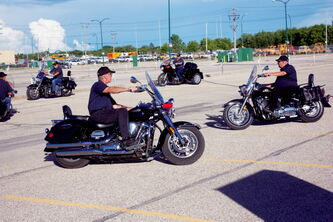 Members of the Motor Patrol ride during the club's practice at Manitoba Hydro's Taylor Avenue office parking lot on June 26.