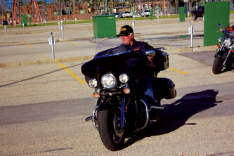 Motor Patrol president Bob Norris rides during the club's practice at Manitoba Hydro's Taylor Avenue office parking lot on June 26.