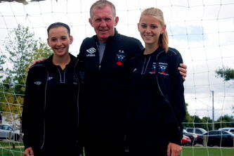 Phoenix Fury head coach Kenny Brannigan is flanked by players Megan Diamond (left) and Mackenzie Jamieson (right). The club recently completed a 12-day tour of Scotland.