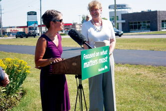 Sara Jane Schmidt of River East Mennonite Brethren Church speaks at an announcement bringing funding to a garden planted by the church and Guru Nanak Darbar Gurdwara. The announcement took place at the garden, located alongside the Northeast Pioneers Greenway at McLeod Avenue and Gateway Road. Rossmere MLA Erna Braun is also shown (right).