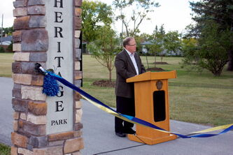 Winnipeg Transcona Rotary Club president Tom Hallas speaks at a press conference announcing the completion of phase 2 of Rotary Heritage Park's revitalization at the park on Sept. 12.