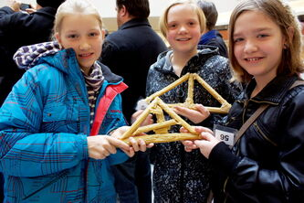 Dr. F.W.L. Hamilton students Jenna Neufeld, Frances Radford, and Raegan Funk show off their bridge designs at the Spaghetti Bridge Building Competition at Kildonan Place on March 9.