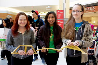 John Taylor Collegiate students Kyra White, Patricia Neameyer, and Natalie Foucart show off their bridge designs at the Spaghetti Bridge Building Competition at Kildonan Place on March 9.