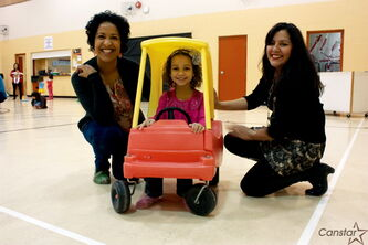Parents Kathy Heppner (left) and Eugenia Lehmann (right) are working to get a Spanish immersion program started in local schools for children like Heppner's daughter Asha (centre).