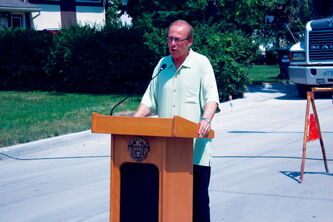 Mayor Sam Katz speaks at a press conference at the corner of Walden Crescent and Blue Heron Crescent on July 4. Walden Crescent is one of 17 streets that will be repaired using money from the Local Street Renewal Reserve Fund.