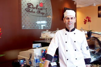 Dolce Bake Shop owner and pastry chef Roberto Galli poses at the bakery.