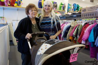 Mom's and Children's Paradise owner Linda Holbrook (right) and her mother and store founder Olive Kramble are shown at the Nairn Ave. store, which will close later this year.