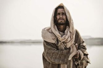 Jesus (Diogo Morgado) as a young man walks along the banks of the River Jordan in Bible miniseries.