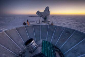 "The sun sets behind the BICEP2 telescope, foreground, and the South Pole Telescope in Antarctica. In the faint glowing remains of the Big Bang, scientists found ""smoking gun"" evidence that the universe began with a split-second of astonishingly rapid growth from a seed far smaller than an atom. To find a pattern of polarization in the faint light left over from the Big Bang, astronomers scanned about 2 percent of the sky for three years with the BICEP2 at the South Pole, chosen for its very dry air to aid in the observations, said the leader of the collaboration, John Kovac of Harvard."