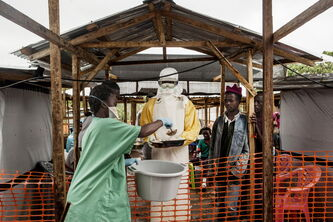 A medical worker collects food for Ebola patients in Kailahun, Sierra Leone.
