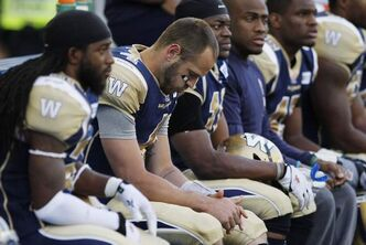 A dejected Winnipeg Blue Bombers' quarterback Buck Pierce (4) sits on the bench during the second half of their CFL game against the Toronto Argonauts.