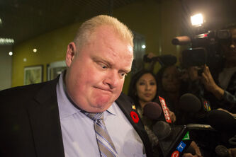 The Toronto mayor address the media outside his office earlier this month.