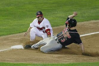 Winnipeg Goldeyes third baseman Amos Ramon tags Fargo-Moorhead Redhawks' Ryan Stovall out at third during the teams' final American Association regular-season game at Shaw Park on Monday night.