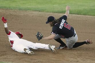 Winnipeg Goldeyes' Price Kendall is tagged out by Fargo-Moorhead RedHawks' Zach Penprase at Shaw Park Tuesday.
