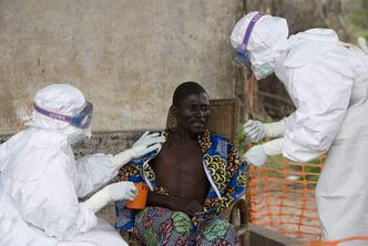 A 43-year-old Congolese patient, centre, who has been confirmed to have Ebola hemorrhagic fever, is comforted by Medecins Sans Frontieres (Doctors without Borders) nurse Isabel Grovas, left, and Doctor Hilde Declerck, right, in Kampungu, Congo,  in 2007.
