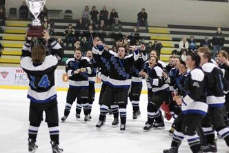Sanford Sabres captain Chase Kendall hoists the championship cup after the team won the Winnipeg High School Hockey League's Free Press Division playoffs, beating the Lord Selkirk Royals 6-1 at the MTS Iceplex on March 12.