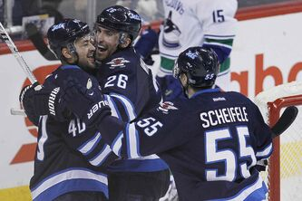 The Jets are hoping to get right back in the air, such as here, where Blake Wheeler (26) and Devin Setoguchi celebrate the winner over Vancouver Jan. 31.