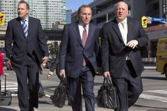 NHL Commissioner Gary Bettman (centre) arrives with Assistant Commissioner Bill Daly (right) for collective bargaining talks in Toronto on Tuesday October 16, 2012. The NHL made a proposal to the NHLPA morning at collective bargaining agreement meetings in Toronto Tuesday: a 50-50 deal on current HRR (hockey-related revenue) definitions.