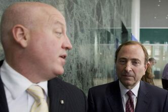 NHL commissioner Gary Bettman (right) leaves with assistant commissioner Bill Daly (left) after collective bargaining talks in Toronto on Tuesday Oct. 16.