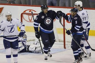Winnipeg Jets' Nik Antropov (80) and Evander Kane (9) celebrate Antropov's goal on Tampa Bay Lightning's goaltender Dwayne Roloson (30) during second period NHL action in Winnipeg on Saturday, April 7, 2012.