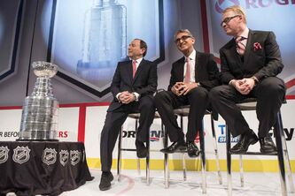 Rogers president and CEO Nadir Mohamed (centre) with NHL commissioner Gary Bettman (left) and Keith Pelley, president of Rogers Media, at a news conference in Toronto on Tuesday.
