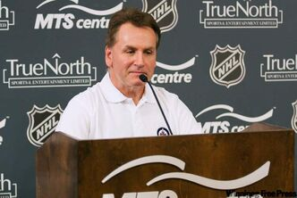 Winnipeg Jets GM Craig Heisinger responds at press conference in Winnipeg Tuesday, regarding the death of Rick Rypien.